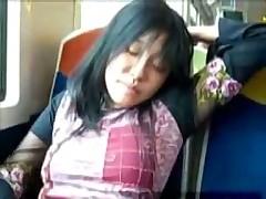 Красивая японочка играет с киской в поезде